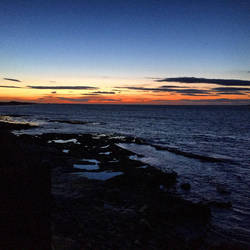 Seahouses Sunset by day-seriani
