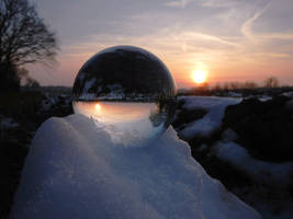 Crystaline sphere on snow pile at sunset by Acrylicdreams