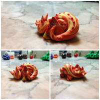 Little Sleeping Fire Swirl Dice Baby by FatDragonArtworks