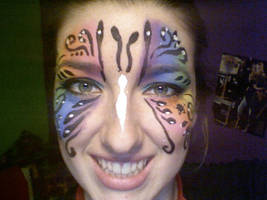 Fun Swirly Rainbow Butterfly Face Paint by lygicaphisalogue