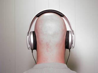 Bald man wearing Headphones 2 by dead-stock