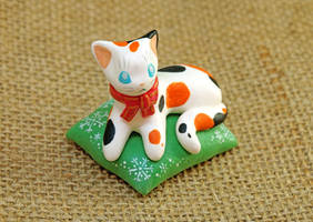 Calico Cat on a Green Pillow by Ailinn-Lein