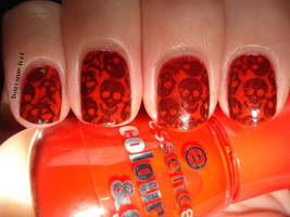 Orange skull nails by naniii