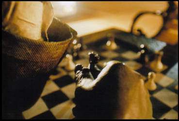 Bronze man plays chess by incubeth
