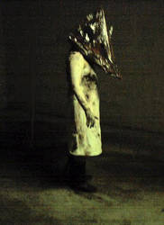 my pyramid head costume shot by MilkToothCuts
