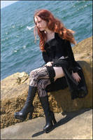 Waiting by the sea. by Elphaba-Skellington