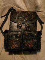 A leather backpack with copper ornament by ChanceZero