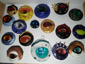 dragon eye magnets and pendants by rei-shiroiakuma