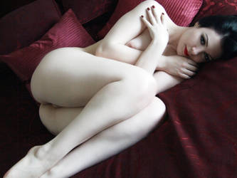 Pale Wht Grl Curled Up by Snapfoto