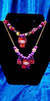 Halloween Hello Kitty Necklace by nuriko-chan