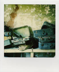 suitcases by vaporiss