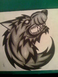 Tribal Snarling Wolf Tattoo Design by Imkihca