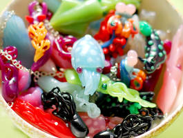 Another pile of sea creature pendants by octopus-interphone