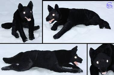Black dog-plushie by IsisMasshiro