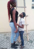 Tall girl short man kiss by lowerrider