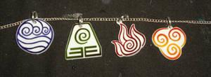 Avatar pendants by ykansaki