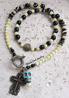 La Santa Muerte necklace by IdolRebel