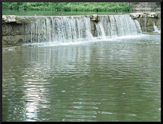 Riverside Waterfall by QueenOftheNight341