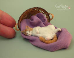Realistic Miniature Sleeping Cat Sculpture by Pajutee