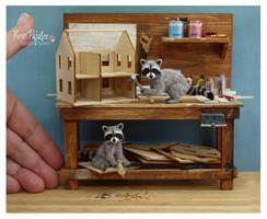 Miniature Raccoon sculptures by Pajutee