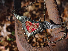Steampunk flying heart necklace by Hiddendemon-666