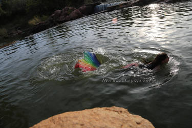 Rainbow mermaid swimming II by QueenWerandra