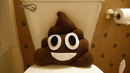 Poop Emoji Pillow by razzmicstrawberry