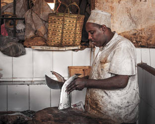 Fishmonger at Darajani Market by Mark-Fisher-Photos
