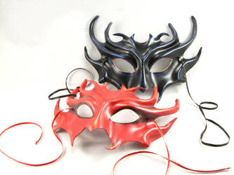Pair of Devil masks by pilgrimagedesign