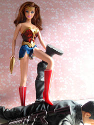 Wonder Woman really knows how to get her men. by maigavin