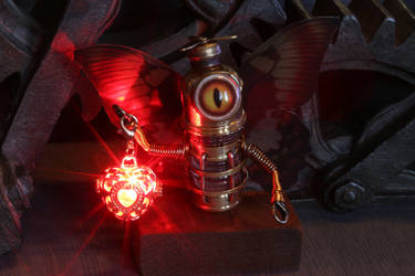 Robot Fairy with red glowing lantern by CatherinetteRings