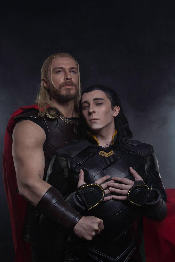 Thor and Loki family photo by TheIdeaFix