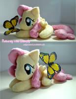 Fluttershy with butterfly by zuckerschnuti