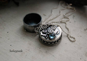 locket with topaz by honeypunk