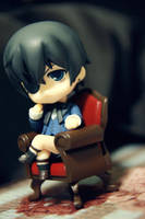 Ciel on L's thinking chair by envyinwondrland