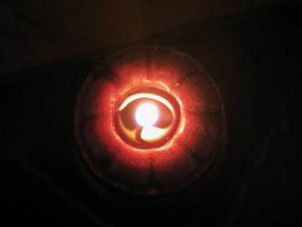 burning candle by writingwonder