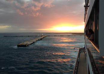 Sunset over the ocean by multifandomed25