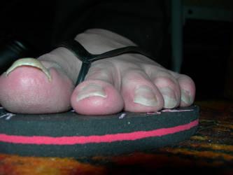 Giant male foot in flip flops by Tinybr