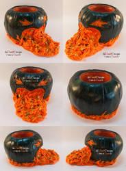Gutted Pumpkin Tealight Holder by spaceship505