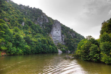 Rock sculpture of Decebalus, king of the Dacians. by RoxyRocz