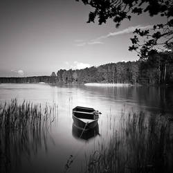 Lonely boat by anoxado