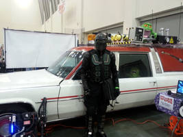 Ninja X in front of Ghostbusters 2016 car 1 of 2 by schooltrashers