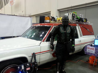 Ninja X in front of Ghostbusters 2016 car 2 of 2 by schooltrashers