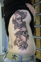 skulls and flowers by deeperthanyou