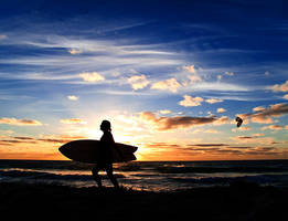 Surfers sunset by LouisStone