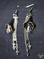 Black lily earrings by Spiked-Fox
