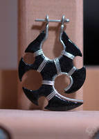 Tribal earring by Spiked-Fox