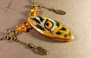 Golden eye necklace by AlviaAlcedo