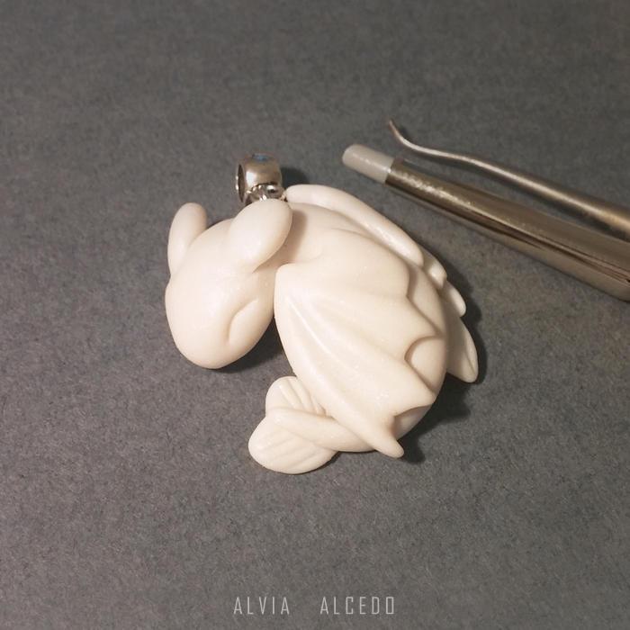Tiny White Fury pendant by AlviaAlcedo