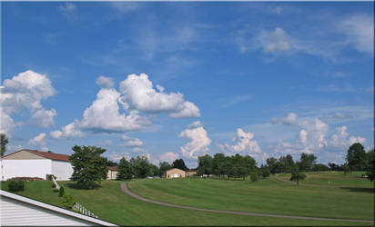 Pretty Clouds- the Golf Course by WDWParksGal-Stock